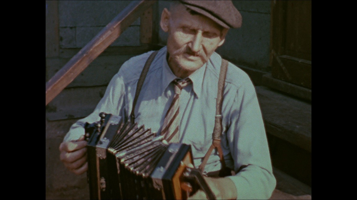 Aapo Juhani playing concertina in a still from Alan Lomax's color film footage, Calumet, Michigan, 1938.