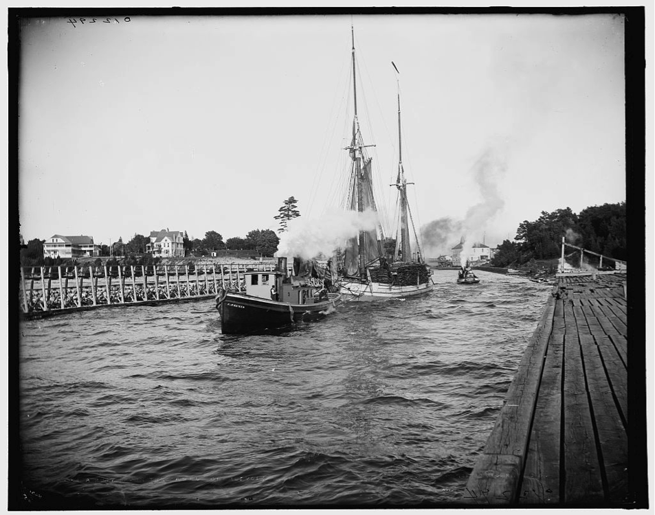 "Timber schooner leaving the channel at Charlevoix, Michigan, 1900. ""The Bigler"" was a timber drogher, a ship specially built to carry squared logs."