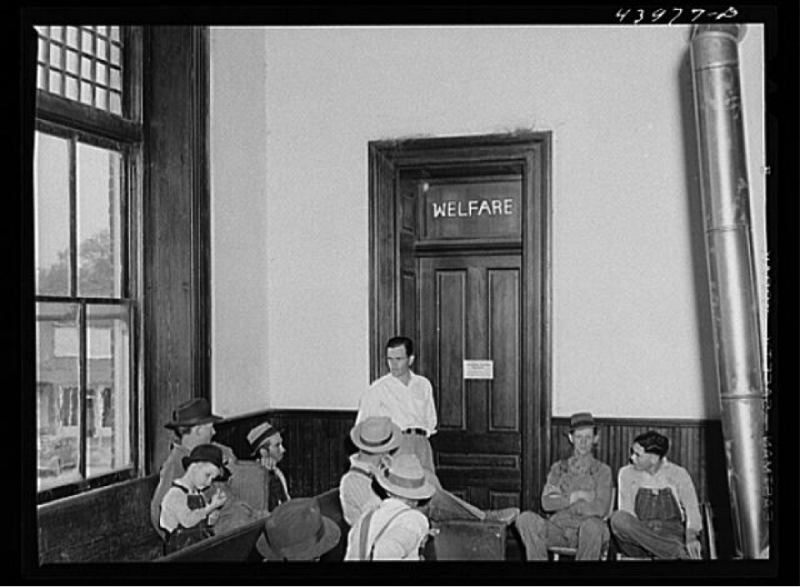 """Waiting their turn at the welfare office in the courthouse,"" Heard County, Georgia."